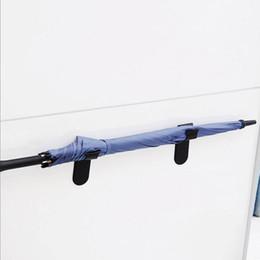 автомобильный зонт Скидка 1PCS зонтик стоять небольшой крюк двери / стены зонтик стоять Прочные самоклеющиеся предметы домашнего обихода поставки автомобилей