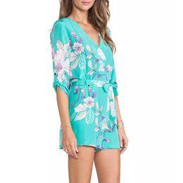 Jumpsuit marca elegante on-line-Céu azul elegante das mulheres macacões de impressão floral calças meia manga Macacão com seashes Zipper casual slim marca calças KZ592