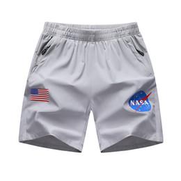 Corti di bandiera mens online-Pantaloncini da uomo della NASA Designer Nero Grigio Hip Hop Bandiera nazionale americana Pantaloni da uomo Pantaloncini da uomo della NASA Pantaloni da donna di grandi dimensioni