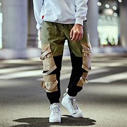 calça de perna aberta Desconto Outono Streetwear Carga Calças Splice Calças Dos Homens Desenhar Corda Cintura Elástica Hip Hop Abertura Da Perna Com Zíper Calças Masculinas EUA tamanho