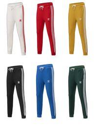 Uomini all'ingrosso di marca Donne Sport casuali Pantaloni lunghi Autunno Nuovo arrivo Uomini Pantaloni sportivi Pantaloni donna 6 colori disponibili Taglia S - 4XL da