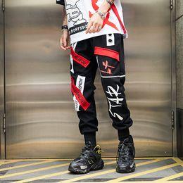 Roupa japonesa do hip hop on-line-2019 Streetwear Dos Homens Corredores Calças Dos Homens Carta Impressão Hip Hop Harém Calças Roupas Masculinas Japonesas Streetwear Calças