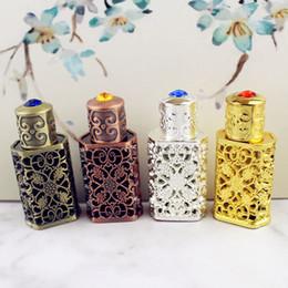 masque pelable blanchissant Promotion Bouteille de parfum en métal vieilli de 3 ml en alliage de style arabe évider la bouteille d'huiles essentielles bouteille de compte-gouttes en verre du Moyen-Orient