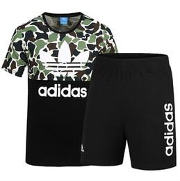 I joggers si adattano agli uomini online-2019 Summer Brand Tuta da uomo Sportswear con lettere Fashion Suit maniche corte Pullover Casual Jogger Pants O-Collo Abbigliamento L-4XL