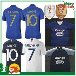 Wholesale 100 Francia MBAPPE GRIEZMANN POGBA maglie anniversario Soccer jersey calcio camicie abbigliamento allenamento uomo donna bambini kit maillot de foot