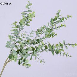 Kleine plastik weihnachtsbaum dekorationen online-Künstlicher Plastikeukalyptusbaumast für Weihnachtshochzeitsdekoration Kleine Blätter der Blumenanordnung pflanzen Imitatlaub
