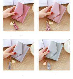 modelos de tarjetas de papel Rebajas Monedero de la mujer diseñador profesional de múltiples colores modelos de explosión de moda popular borla colgante lichi tarjeta de clip