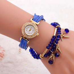 Pendentif en perles tricotées à la main avec diamants et petites montres au poivre quand la montre bracelet bracelet d'ornement ? partir de fabricateur