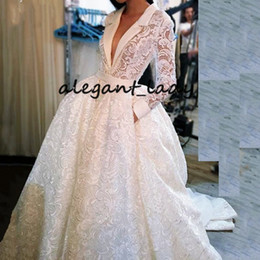 vintage summer dress designs Coupons - Vintage Crochet Lace Wedding Dresses with Pocket Design 2019 Sexy V-neck Long Sleeve Puffy Skirt Arabic Castle Bridal Wear for Wedding