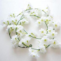 Seide hängende wand blumen dekor online-200 cm Sakura Kirsche Rattan Hochzeit Bogen Dekoration Rebe Künstliche Blumen Home Party Decor Silk Ivy Wandbehang Girlande Kranz