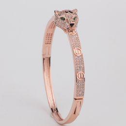 i migliori modelli in oro dei braccialetti Sconti Bracciale donna con diamanti a forma di testa di leopardo femmina Bracciale gioielli di design di lusso con diamanti Gioielli di san Valentino in vendita