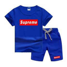 2019 trajes de pieza de solapa delgada LOGO SPE de lujo de diseño clásico Boy Conjunto 2-7T recién nacidos para niños y niñas de los bebés remata la camiseta y los pantalones 2pcs de los equipos fijó la ropa