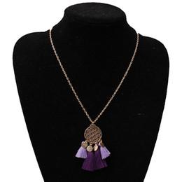 Collar de aleación bohemia online-Collar bohemio cuerda de algodón borla de aleación colgante hueco redondo collar femenino largo colgante de joyería
