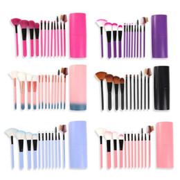 Pinceles de maquillaje porta vasos online-12 Unids / set Brochas de Maquillaje Herramienta Sombra de Ojos Fundación Ceja Cepillo de Labios cosméticos Portavasos de Cuero Estuche Kit 50 sets / lote DHL