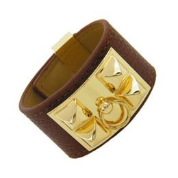 Braccialetti del braccialetto del rivetto online-2019 nuovo Alloy Fashion punk rivetti grandi braccialetti H per le donne cuoio dell'unità di elaborazione in pelle polsino bracciale versione ampia gioielli in oro braccialetti all'ingrosso