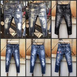 Jeans curtos destruídos on-line-Desgaste dos homens Rasgado Skinny Jeans shorts jeans Designer Slim Fit Denim Destruído Calças Jeans Para Homens 875