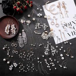 сердце формы длинные серьги Скидка 3* New hollow long heart-shaped pendant earrings Sweet simulated pearl geometric tassel earrings Brinco women's fashion jewelry