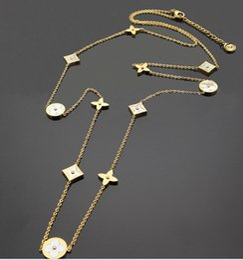 Encantos comerciais on-line-Aço de titânio comércio exterior charme branco shell colar trevo longo camisola cadeia colar 11 flores longo colar para as mulheres
