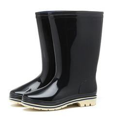 Botas de invierno de plástico para mujer. online-Zapatos de mujer de plástico de invierno de color sólido de alto barril de seguridad botas de punta de lluvia zapatos antideslizantes impermeables zapatos de lluvia lluvia zapato sy412