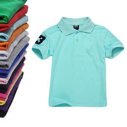 Argentina ¡Venta al por mayor! Camiseta de polo para niños Camiseta de manga corta con solapa para niños Camiseta de niños Tops Ropa Marcas de color sólido Camisetas de algodón para niñas Suministro