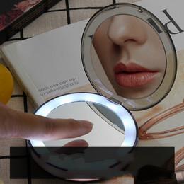 Argentina llevado espejo de maquillaje mini portátil LED de carga plegable componen la luz de relleno espejo 3 veces portátil espejo Suministro