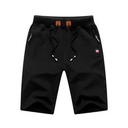calças de praia de malha Desconto 2019 verão estilo quente dos homens de malha de esportes calças de algodão 5 minutos de calças praia