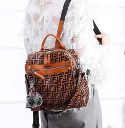 Mochilas de pu online-Mochila de diseñador más vendida para mujer Mens Causal Mochila de cuero de la pu Bolsos de moda Mochila escolar de los adolescentes Mochila