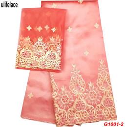 Argentina Diseño indio indio del cordón de George para el vestido de boda nigeriano Tissu lentejuelas línea de oro bordado George telas de seda de encaje G1001 Suministro