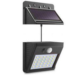 Высокое качество отделяемой панели солнечных батарей наружного LED настенный светильник датчик движения / ночной датчик солнечного света для сада ночной свет # 1108 от
