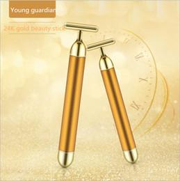 24K haste ouro beleza beleza barra fina vibração rosto instrumento de massagem facial T-tipo de rosto instrumento importação elétrica de Fornecedores de silicone de qualidade