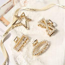 2019 garras pinzas para el cabello perlas Elegante cristal de imitación perla Clip de pelo garra estrella arco encanto horquilla cangrejo aleación oro pelo garra mujeres Hair Styling herramientas SH190727 rebajas garras pinzas para el cabello perlas