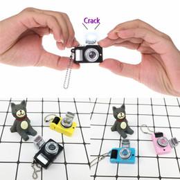 lueur de la caméra Promotion Caméra jouet Porte-clés 4 couleurs Poupée Accessoires enfants Jouets Projection Enfants appareils photo Son Lumineux Brillant pendentif jouet cadeau JY510