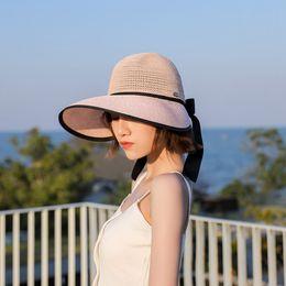 Sombrero de paja grande online-Lady Beach Sombrero de paja Mujer Viaje Gran sol amplio Gorra Verano Sol Sombreado Color sólido Bowknot Cinta Sombrero TTA972