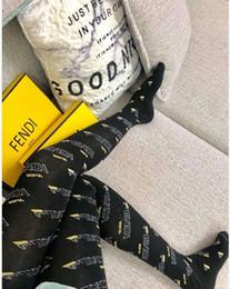 Calças brancas apertadas on-line-Moda preto branco Lace Mesh Oco Out Meia-calça Marca Europeia Sexy malha meias hosierys Hot F Carta Leggings Meias para As Mulheres