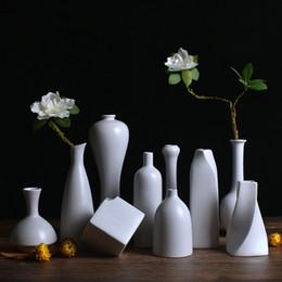 Europa Creativo Vaso di ceramica Nero / bianco Vasi da tavolo Vaso di moda moderna Vaso di fiori Decorazioni per la casa Artigianato Decorazione di nozze da nero vasi da sposa bianco fornitori