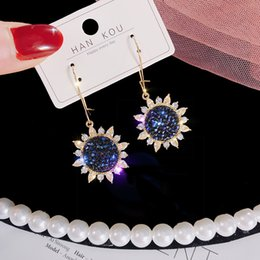 Cielo hermoso diamante online-Aplicable Beautiful Girl's Sky Blue Sun Flower Pendientes Pendientes largos del estilo Cara fina Red Pendientes Joyas de diamantes de alta calidad