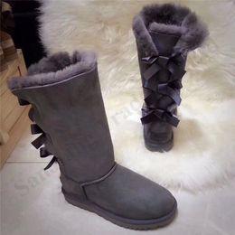 Zapatos de mujer online-Cargador de la nieve muchachas de la marca Botas Zapatos Australia invierno la nieve de alta botas UG Tres arcos clásico de moda de las mujeres de los hombres del cuero genuino de la vaca del ante HC102401