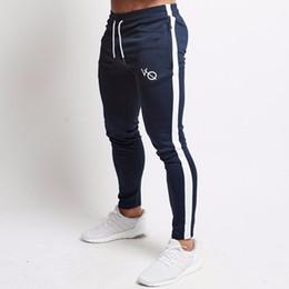 2019 calças homem casual Mens Corredores Calças Casual Homens de Fitness Sportswear Faixas de Treino Skinny Sweatpants Calças Ginásio Preto Calças de Jogger Pista desconto calças homem casual