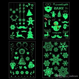 2019 cámara de escenario Resplandor en la oscuridad Tatuaje de Navidad Muñeco de nieve Santa Reno Copo de nieve Tatuajes desechables Fiesta Navideña Drop Ship 110213