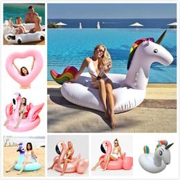 Estampado de flores gigante cisne flotador inflable para adultos fiesta en la piscina juguetes Green Flamingo Ride-On colchón de aire anillo de natación Boia desde fabricantes
