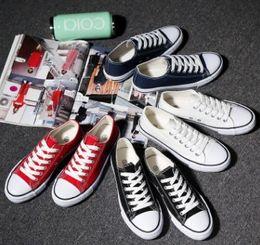sapatas running feitas sob medida baratas Desconto Novos Sapatos de Lona de Qualidade das Mulheres e dos homens de Alta Baixa Estilo Clássico Sapatos de Lona Sapatas de Lona Casuais