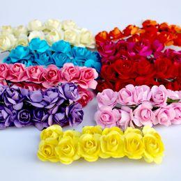 2019 rosas a granel Venta a granel 144 unids 1 cm barato flores de papel artificial para boda rosas falsas de coches utilizadas para la decoración caja de dulces diy guirnalda hecha a mano rosas a granel baratos