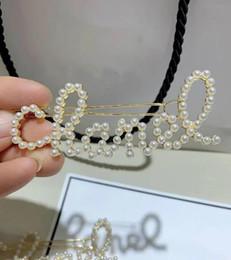 accessori perla Sconti 2019 ~ Classico scava fuori fermaglio per capelli moda clip Classic perla lusso lettere accessori per capelli matel bobby pin regalo VIP