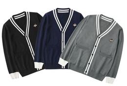 v-pullover männer tragen Rabatt Herbst und Winter neue Männer und Frauen Pullover Europa und den Vereinigten Staaten Mode Stickerei Druck atmungsaktive Liebhaber tragen gestrickte V-Ausschnitt