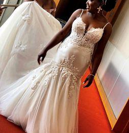 Abbigliamento modesto Mermaid africana Abiti da sposa pizzo applique Tromba Abiti da sposa Beach plus size abito Corte dei treni Robes de mariée soirée da