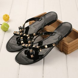 e29d01bec99 Stylish Women Sandals Rivets Bowknot Flat Slippers Girls Flip Flops Elegant Summer  Shoes Cool Beach Jelly Shoes discount women stylish flat sandals