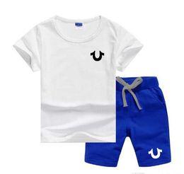 Jungs jogging anzüge online-U Logo Luxus Designer Jungen Mädchen Kleidung Set Kurzarm Top Hose 2 Stücke Outfits Kinder Bebes Kleidung Kinder Jogging anzüge