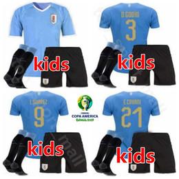 Maglie uruguay online-Uruguay Youth Jersey 2019 Copa America Calze Kids Soccer Set SUAREZ CAVANI GODIN STUANI GIMENEZ Maglia da calcio Kit Uniform Personalizzato Nome