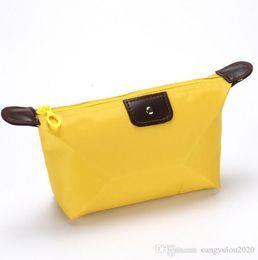 bolsas de cosméticos amarillas casos Rebajas Venta al por mayor nuevas bolsas de cosméticos de gran capacidad portátiles de la Sra. viajes bolsa de lavado grande mujeres bolsa de almacenamiento de nylon impermeable amarillo envío gratis