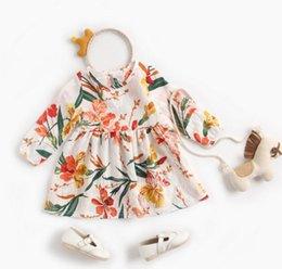 Largos vestidos de niña de flores impresas online-Niña Ropa de diseñador para niños Vestido Primavera Otoño Vestido de diseño de manga larga con estampado de flores suaves Vestido elegante y elegante para niña